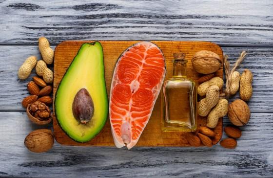 53059744 - healthy fat salmon, avocado, oil, nuts. selective focus